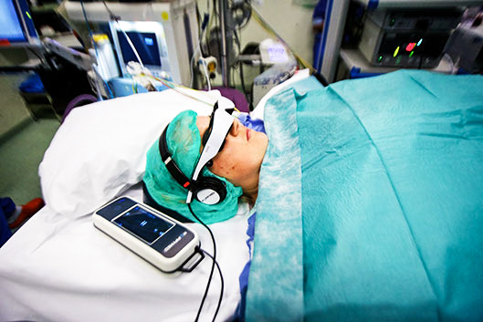 Watching movie during operation could prevent tress and help recovery process